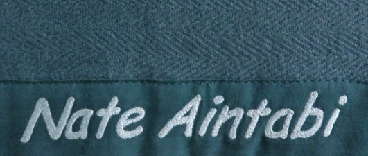 inscription on pashmina baby blanket, italic script